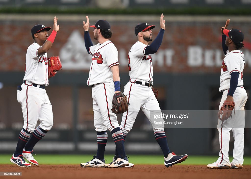 Ronald Acuna #13, Dansby Swanson #7, Nick Markakis #22, and Ozzie Albies #1 of the Atlanta Braves celebrate after the game against the Miami Marlins at SunTrust Park on July 30, 2018 in Atlanta, Georgia.