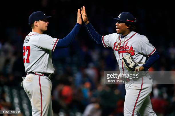 Ronald Acuna Jr. #13 and Austin Riley of the Atlanta Braves celebrate beating the San Francisco Giants at Oracle Park on May 22, 2019 in San...