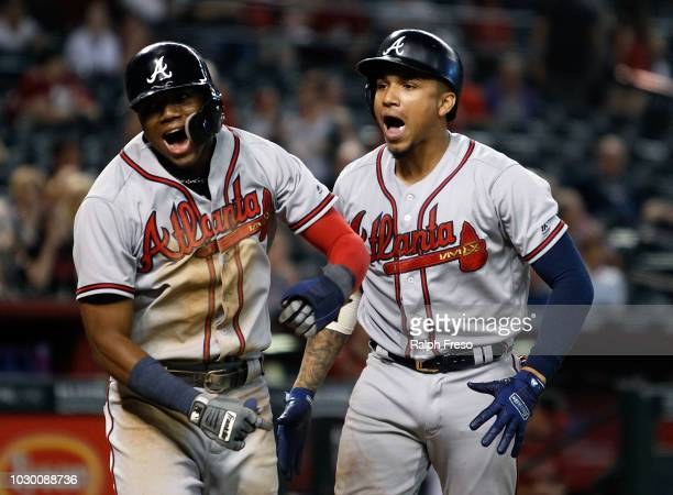 Ronald Acuna Jr #13 and Johan Camargo celebrate after Camargo's tworun home run against the Arizona Diamondbacks during the ninth inning of an MLB...