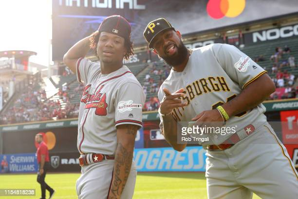Ronald Acuna Jr #13 of the Atlanta Braves and Felipe Vazquez of the Pittsburgh Pirates and are seen on the field prior to the 90th MLB AllStar Game...