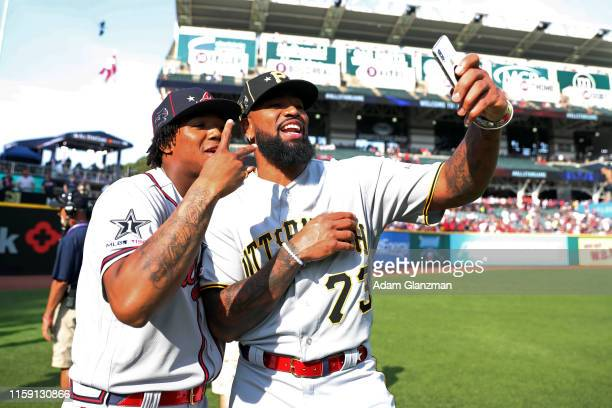 Ronald Acuna Jr #13 of the Atlanta Braves and Felipe Vazquez of the Pittsburgh Pirates take a selfie together prior to the 90th MLB AllStar Game at...