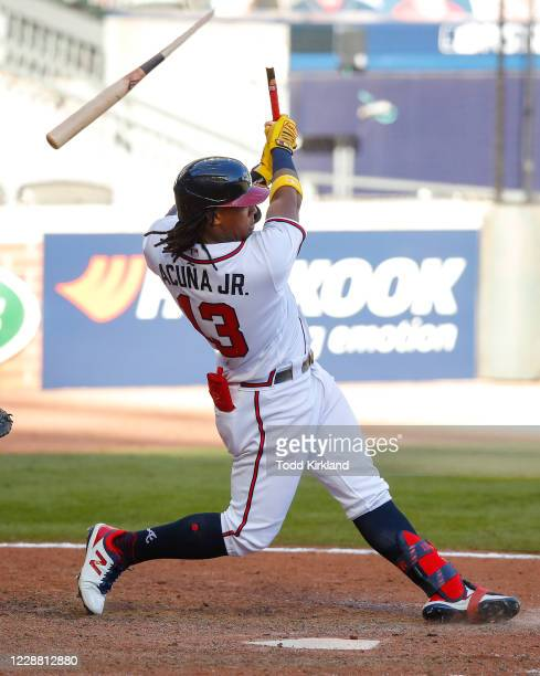 Ronald Acuna Jr. #13 of the Atlanta Braves breaks his bat as he grounds into a force out at second in the thirteenth inning of Game One of the...