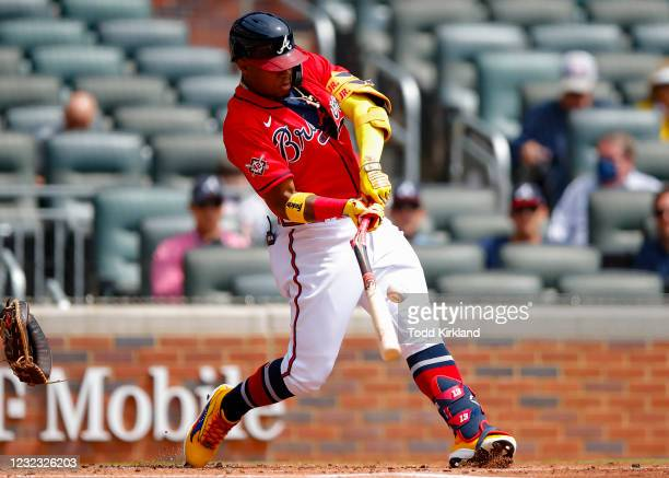 Ronald Acuna Jr. #13 of the Atlanta Braves breaks his bat in the first inning of an MLB game against the Miami Marlins at Truist Park on April 15,...