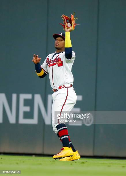 Ronald Acuna Jr. #13 of the Atlanta Braves catches a fly ball in the ninth inning against the Toronto Blue Jays at Truist Park on May 12, 2021 in...