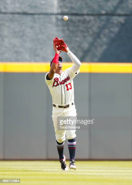 Ronald Acuna Jr #13 of the Atlanta Braves catches a fly ball in the ninth inning of an MLB game against the Arizona Diamondbacks at SunTrust Park on...
