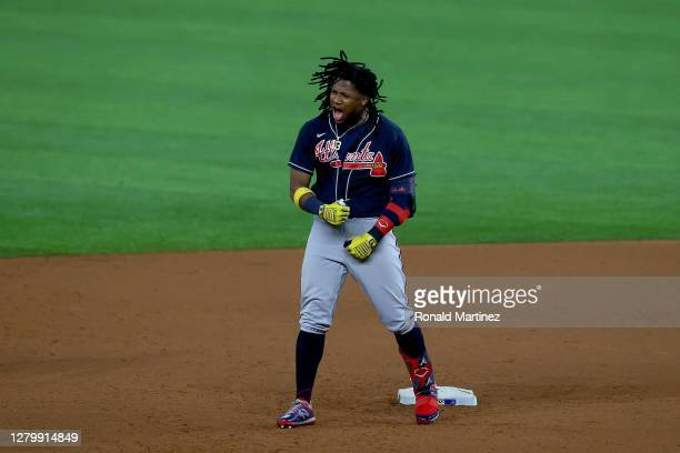 Ronald Acuna Jr. #13 of the Atlanta Braves celebrates a double against the Los Angeles Dodgers during the ninth inning in Game One of the National...