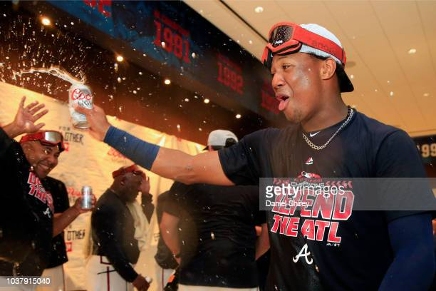 Ronald Acuna Jr #13 of the Atlanta Braves celebrates after clinching the NL East Division against the Philadelphia Phillies at SunTrust Park on...