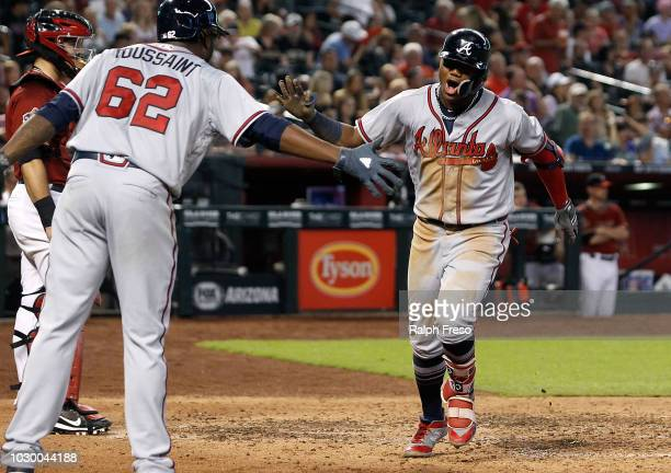 Ronald Acuna Jr #13 of the Atlanta Braves celebrates after hitting a tworun home run against the Arizona Diamondbacks as teammate Touki Toussaint...
