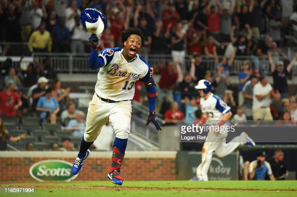 Ronald Acuna Jr. #13 of the Atlanta Braves celebrates after hitting a walk off run in the 10th inning against the Cincinnati Reds at SunTrust Park on...