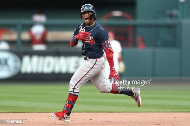 Ronald Acuna Jr. #13 of the Atlanta Braves celebrates after hitting a double against the St. Louis Cardinals during the ninth inning in game four of...