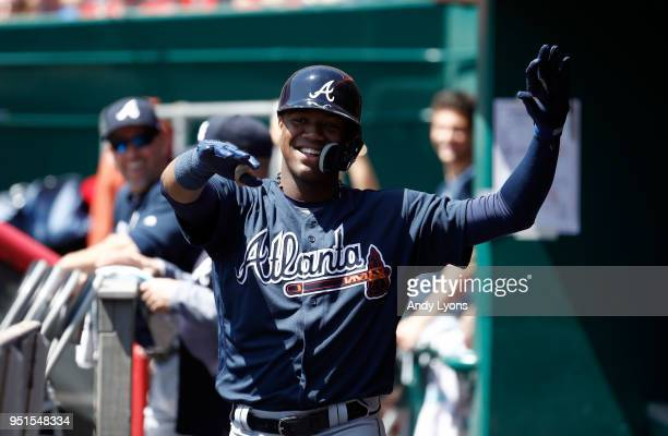 Ronald Acuna Jr #13 of the Atlanta Braves celebrates after hitting his first MLB home run in the second inning against the Cincinnati Reds at Great...