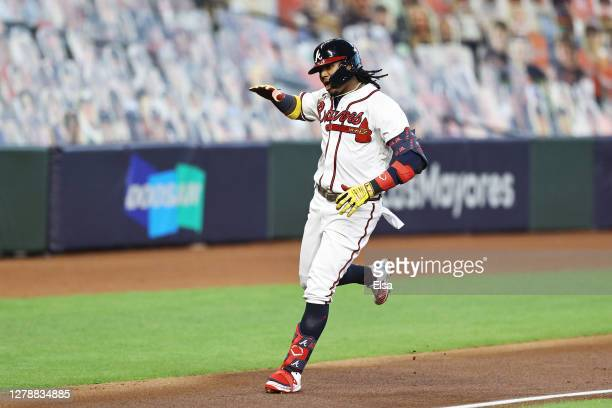 Ronald Acuna Jr. #13 of the Atlanta Braves celebrates his home run during the first inning against the Miami Marlins in Game One of the National...