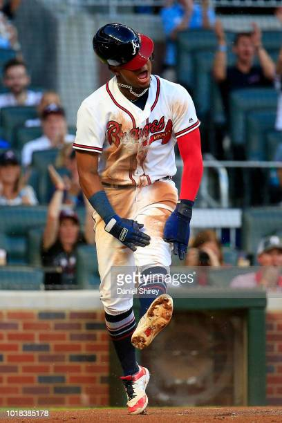 Ronald Acuna Jr #13 of the Atlanta Braves celebrates scoring a run during the first inning against the Colorado Rockies at SunTrust Park on August 17...