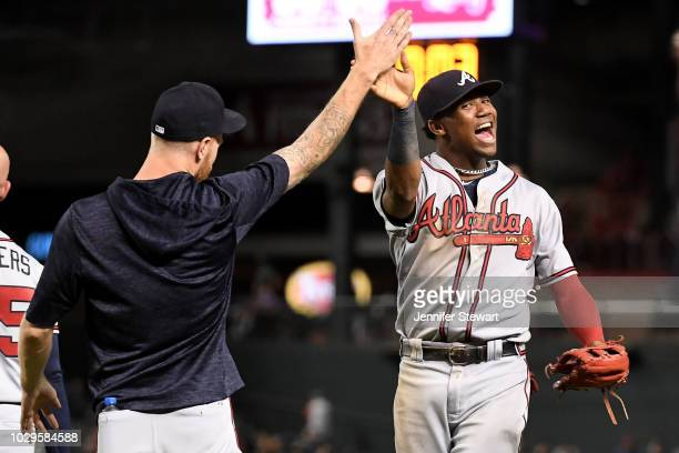 Ronald Acuna Jr #13 of the Atlanta Braves celebrates with Mike Foltynewicz after defeating the Arizona Diamondbacks in the tenth inning of the MLB...