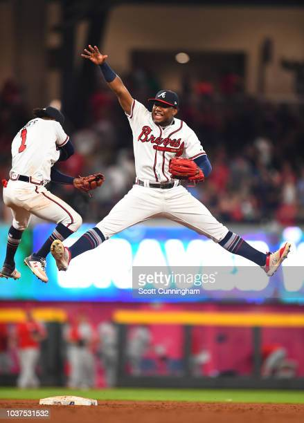 Ronald Acuna Jr #13 of the Atlanta Braves celebrates with Ozzie Albies after the game against the Philadelphia Phillies at SunTrust Park on September...