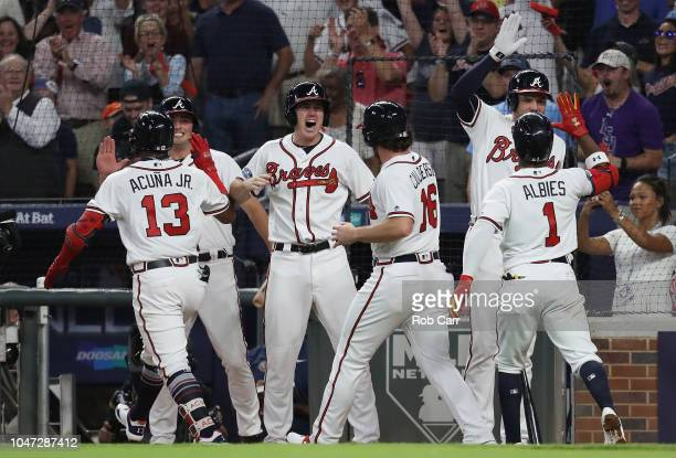Ronald Acuna Jr #13 of the Atlanta Braves celebrates with teammates after hitting a grand slam in the second inning against the Los Angeles Dodgers...