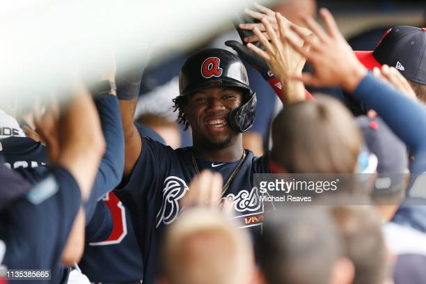 Ronald Acuna Jr #13 of the Atlanta Braves celebrates with teammates after hitting a solo home run in the fourth inning against the St Louis Cardinals...