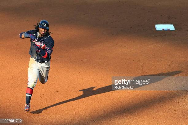 Ronald Acuna Jr. #13 of the Atlanta Braves circles the bases after he hit a home run during the fifth inning against the Philadelphia Phillies in...