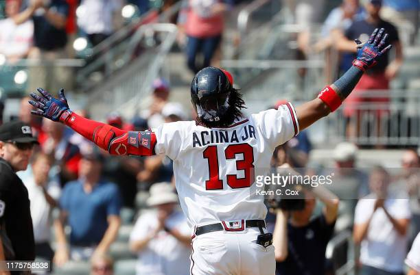 Ronald Acuna Jr #13 of the Atlanta Braves crosses home plate after hitting his 40th homer in the third inning against the Philadelphia Phillies at...