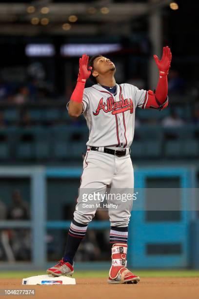Ronald Acuna Jr #13 of the Atlanta Braves hits a double during the first inning against the Los Angeles Dodgers during Game Two of the National...