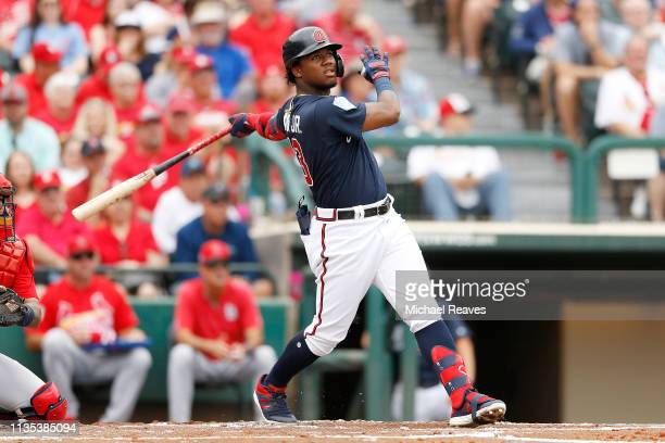 Ronald Acuna Jr #13 of the Atlanta Braves hits a double in the second inning against the St Louis Cardinals during the Grapefruit League spring...