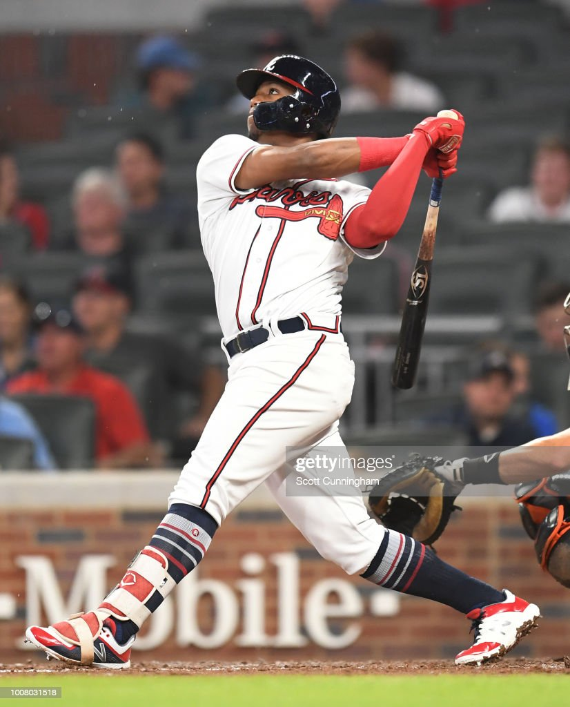 Ronald Acuna, Jr. #13 of the Atlanta Braves hits a fifth inning solo home run against the Miami Marlins at SunTrust Park on July 30, 2018 in Atlanta, Georgia.