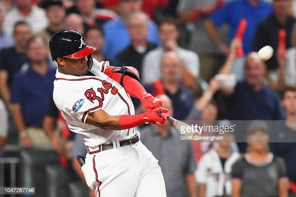Ronald Acuna Jr #13 of the Atlanta Braves hits a grand slam home run in the second inning against the Los Angeles Dodgers during Game Three of the...