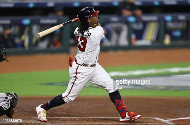 Ronald Acuna Jr. #13 of the Atlanta Braves hits a home run during the first inning against the Miami Marlins in Game One of the National League...