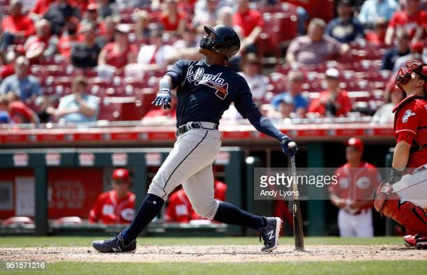 Ronald Acuna Jr #13 of the Atlanta Braves hits a RBI double in the 8th inning against the Cincinnati Reds at Great American Ball Park on April 26...