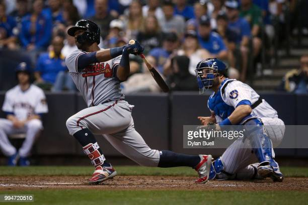 Ronald Acuna Jr #13 of the Atlanta Braves hits a single in the seventh inning against the Milwaukee Brewers at Miller Park on July 6 2018 in...