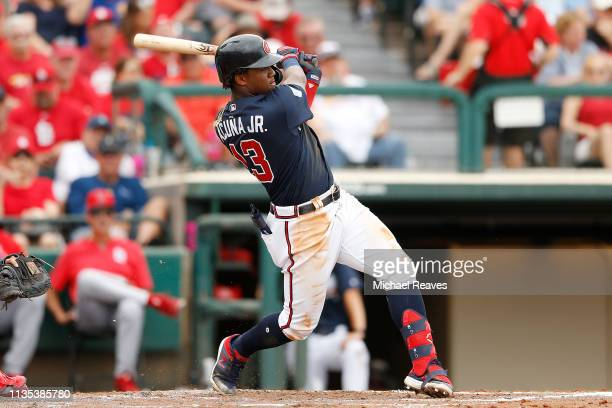 Ronald Acuna Jr #13 of the Atlanta Braves hits a solo home run in the fourth inning against the St Louis Cardinals during the Grapefruit League...