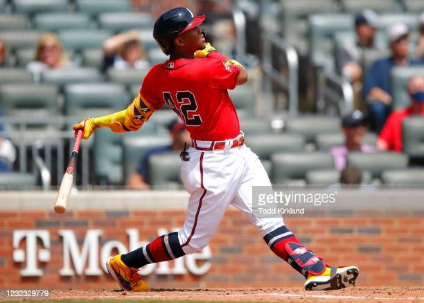 Ronald Acuna Jr. #13 of the Atlanta Braves hits a two run home run in the fifth inning of an MLB game against the Miami Marlins at Truist Park on...