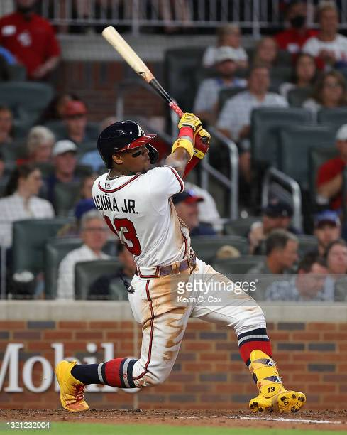 Ronald Acuna Jr. #13 of the Atlanta Braves hits a two-run homer in the fifth inning against the Washington Nationals at Truist Park on June 01, 2021...