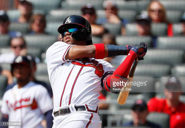 Ronald Acuna Jr. #13 of the Atlanta Braves hits his 40th homer in the third inning against the Philadelphia Phillies at SunTrust Park on September...