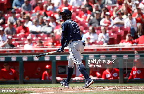 Ronald Acuna Jr #13 of the Atlanta Braves hits his first MLB home run in the second inning against the Cincinnati Reds at Great American Ball Park on...