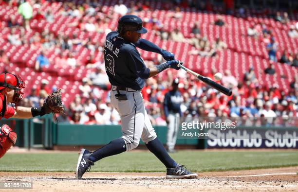 Ronald Acuna Jr #13 of the Atlanta Braves hits the ball in the fourth inning against the Cincinnati Reds at Great American Ball Park on April 26 2018...