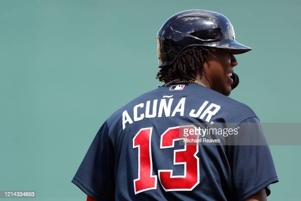 Ronald Acuna Jr #13 of the Atlanta Braves in action against the Houston Astros during a Grapefruit League spring training game at CoolToday Park on...