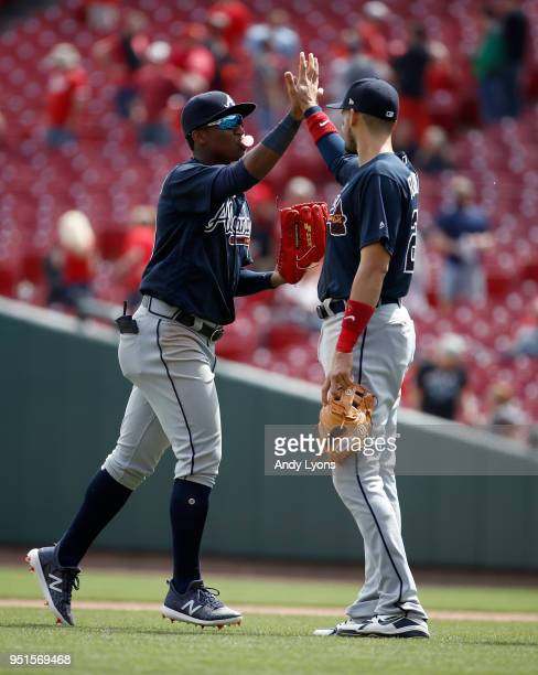 Ronald Acuna Jr #13 of the Atlanta Braves is celebrates with a teammate after the 74 win against the Cincinnati Reds at Great American Ball Park on...