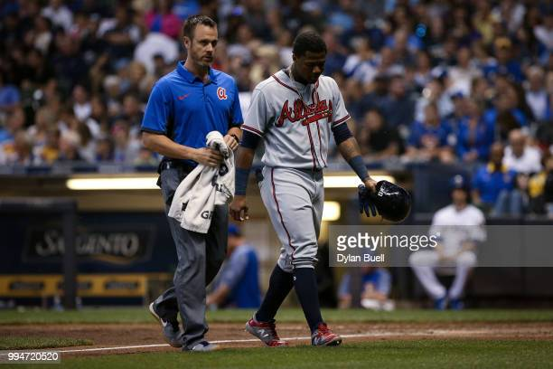 Ronald Acuna Jr #13 of the Atlanta Braves leaves the game after being injured in the seventh inning against the Milwaukee Brewers at Miller Park on...