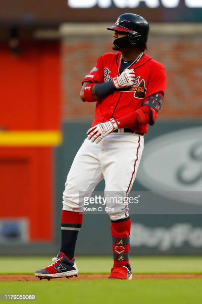 Ronald Acuna Jr. #13 of the Atlanta Braves reacts after a double off Jack Flaherty of the St. Louis Cardinals in the seventh inning in game two of...