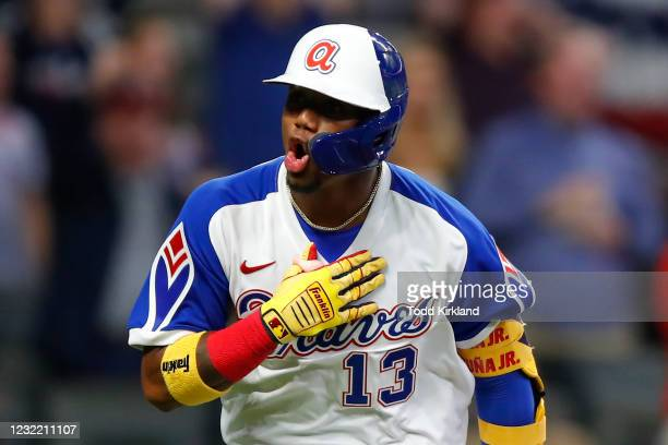 Ronald Acuna Jr. #13 of the Atlanta Braves reacts after a two run home run in the fifth inning of an MLB game against the Philadelphia Phillies at...