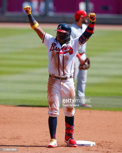 Ronald Acuna Jr. #13 of the Atlanta Braves reacts after hitting a run scoring double in the fifth inning of Game Two of the National League Wild Card...