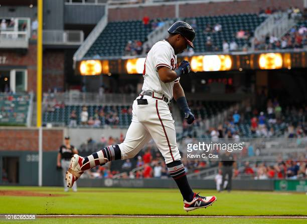 Ronald Acuna Jr #13 of the Atlanta Braves reacts after hitting a solo homer to lead off game two of a doubleheader against the Miami Marlins at...