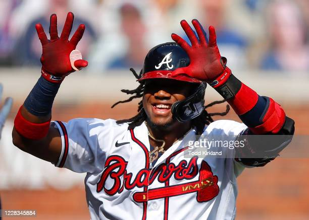 Ronald Acuna Jr. #13 of the Atlanta Braves reacts after hitting a solo home run in the first inning of game one of an MLB doubleheader against the...