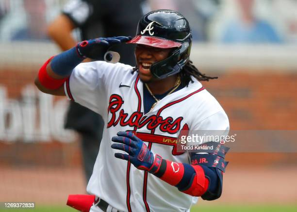 Ronald Acuna Jr. #13 of the Atlanta Braves reacts after hitting a solo home run in the first inning of game one of the MLB doubleheader against the...