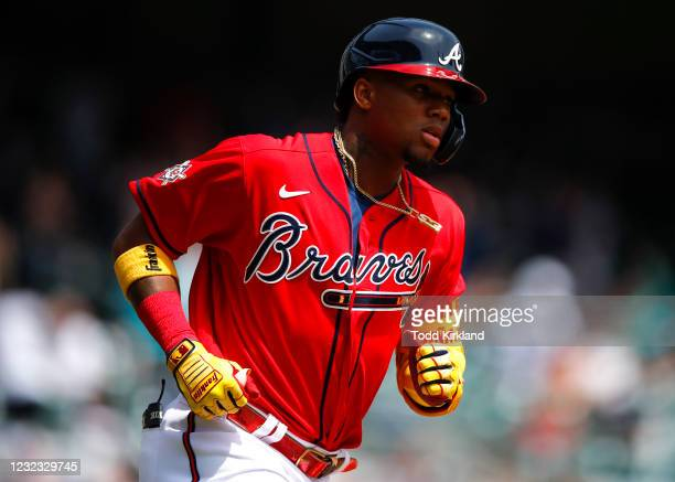 Ronald Acuna Jr. #13 of the Atlanta Braves reacts after hitting a two run home run in the fifth inning of an MLB game against the Miami Marlins at...