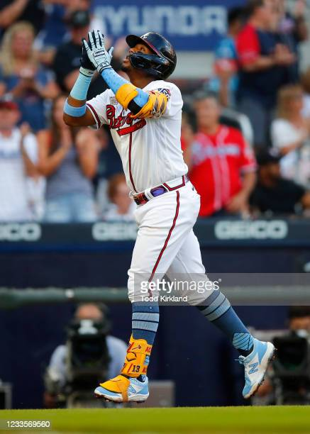 Ronald Acuna Jr. #13 of the Atlanta Braves reacts after hitting his 100th career home run in the third inning of game two of a doubleheader against...