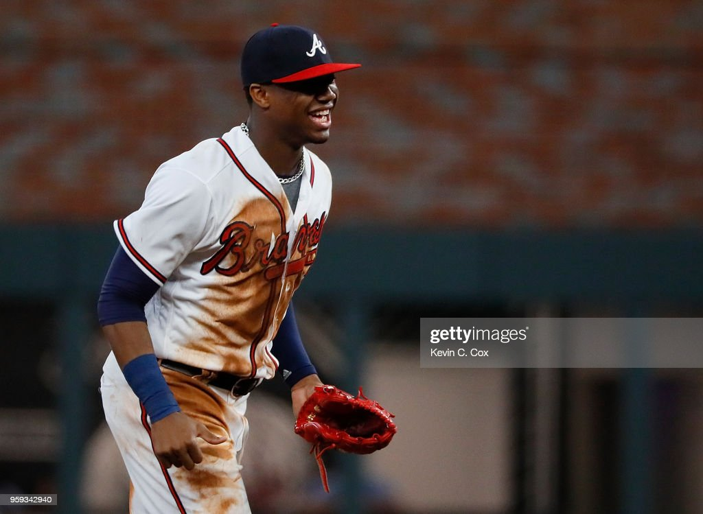 Ronald Acuna Jr. #13 of the Atlanta Braves reacts after their 4-1 win over the Chicago Cubs at SunTrust Park on May 16, 2018 in Atlanta, Georgia.