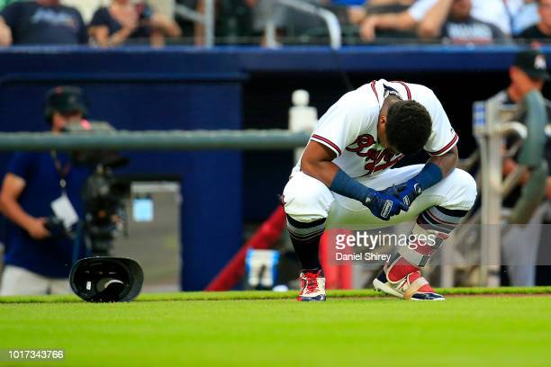 Ronald Acuna Jr #13 of the Atlanta Braves is hit by the first pitch of the game against the Miami Marlins at SunTrust Park on August 15 2018 in...