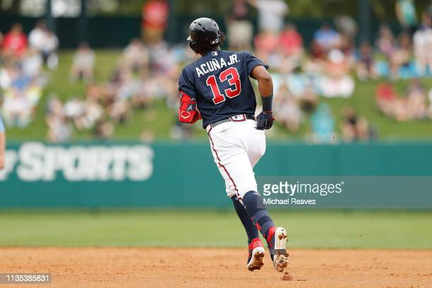 Ronald Acuna Jr #13 of the Atlanta Braves rounds the bases after hitting a solo home run in the fourth inning against the St Louis Cardinals during...